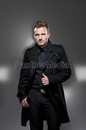 mid adult man in black coat