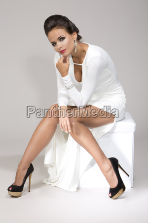 woman wearing white gown studio shot