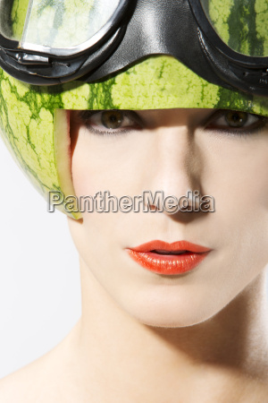 portrait of young woman wearing watermelon