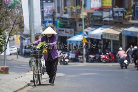 vietnam da lat woman with bicycle