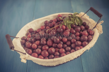 red mirabelles in a basket