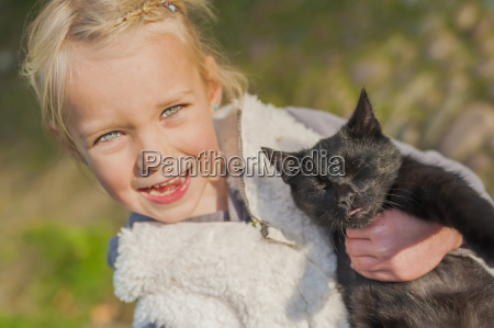 portrait of little girl with cat