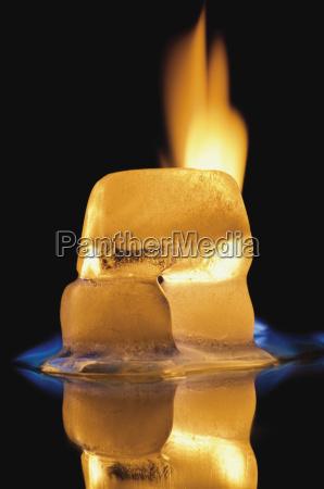 ice cube burning on black background
