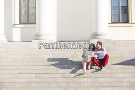 poland warsaw young couple sitting on