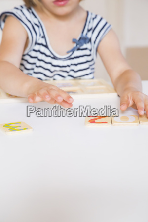 little girl learning figures with wooden