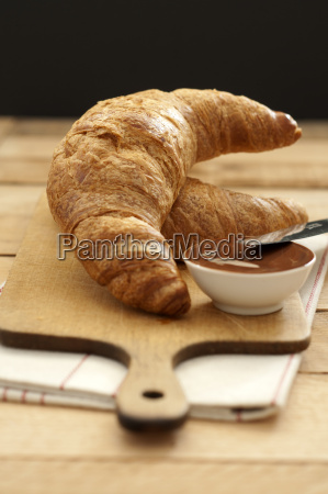 croissants with bowl of chocolate sauce