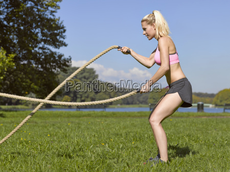 germany young woman doing sports with