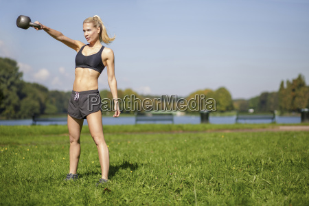germany young woman swinging a kettlebell