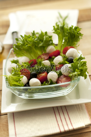 plate of salad with tomatoes and