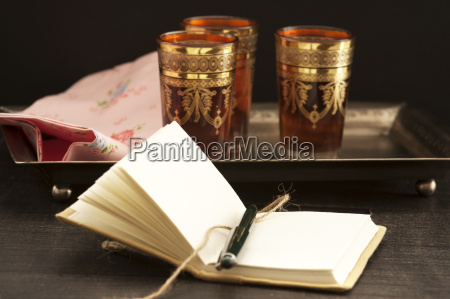 black tea with book on wooden