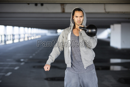 man wearing hooded jacket training with