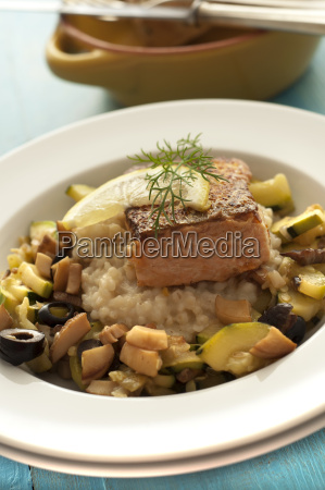 plate of salmon with pearl barley