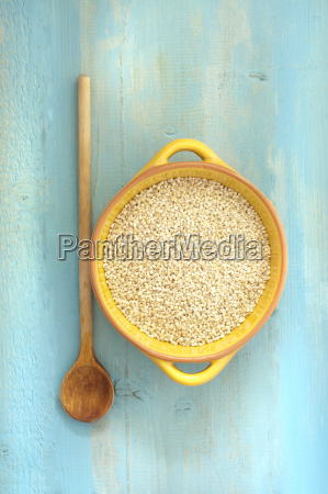 bowl of pearl barley with wooden