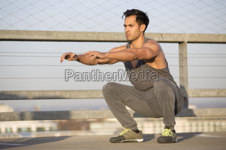 muscular man doing squats