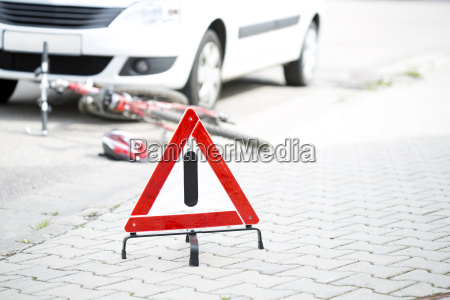 warning triangle in front of crash