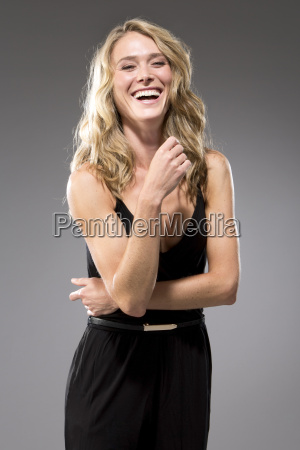 portrait of laughing woman wearing black