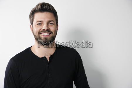 portrait of smiling man with beard