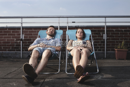 germany berlin couple relaxing on roof