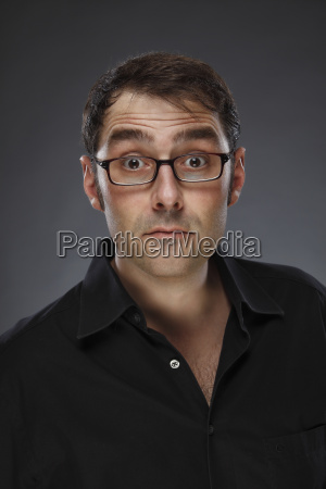 portrait of sceptical man wearing glasses