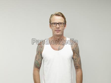 portrait of mature man with tatoos