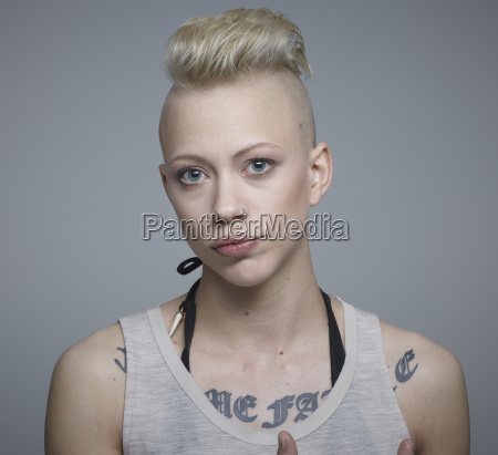portrait of young woman with tattoos