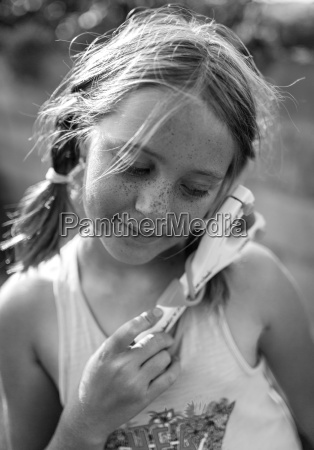 portrait of girl with slingshot