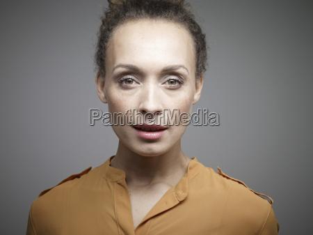 portrait of mid adult woman against