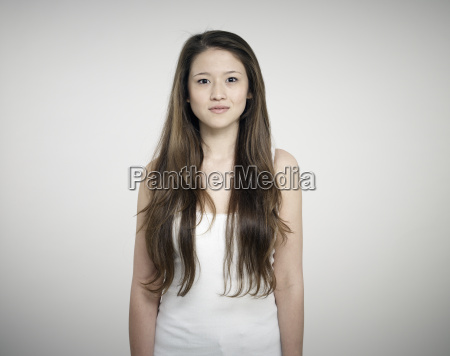 portrait of young woman standing against