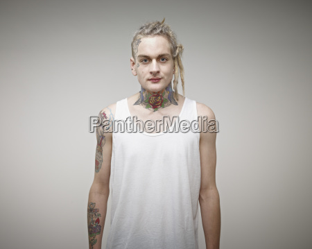 portrait of young man with tattoos