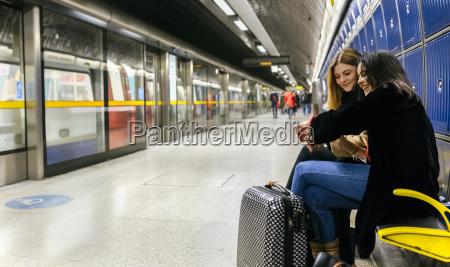 uk london two young women waiting