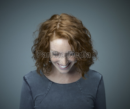 portrait of smiling redheaded woman looking
