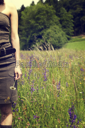 woman standing on a flower meadow