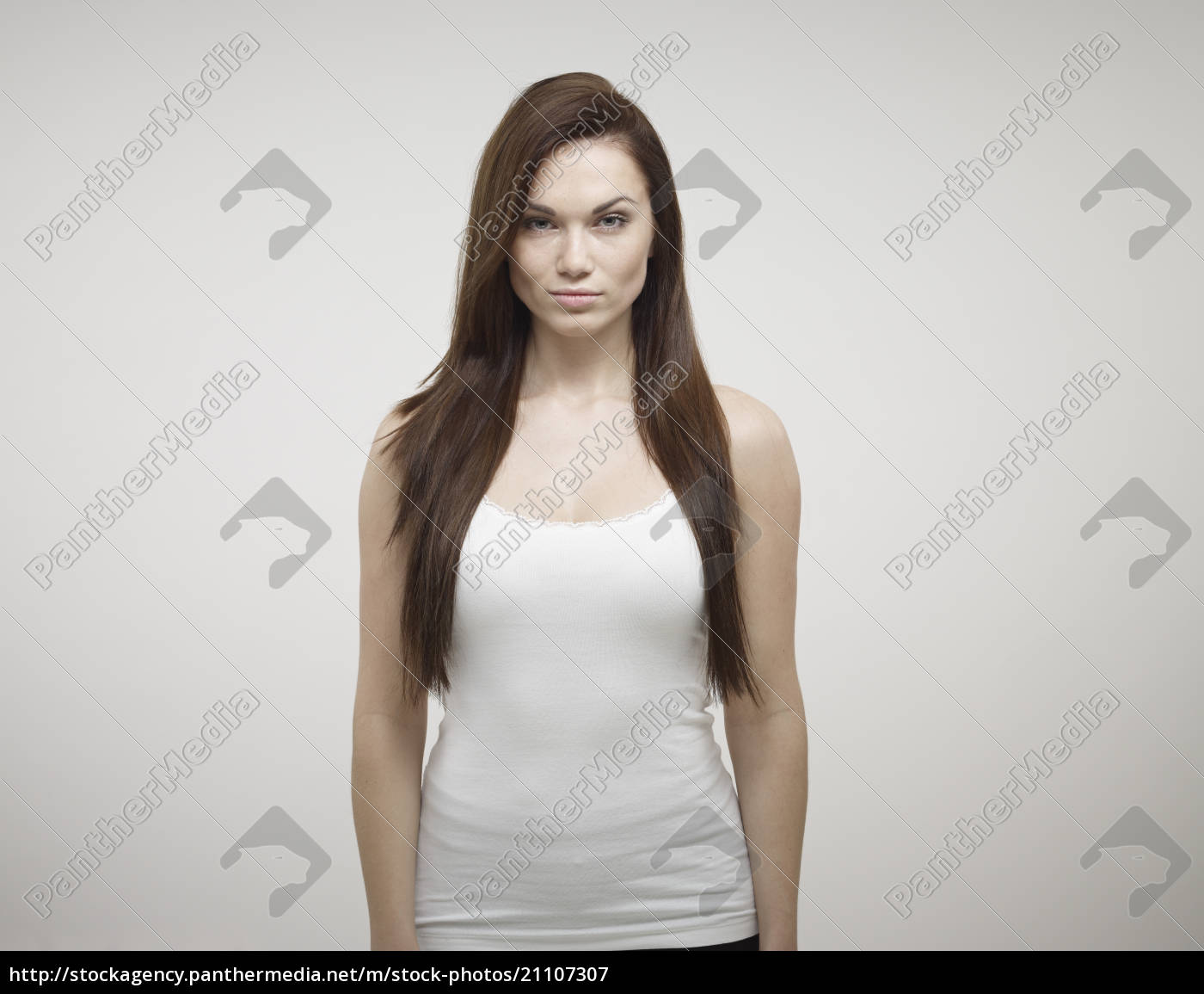 portrait, of, young, woman, standing, against - 21107307
