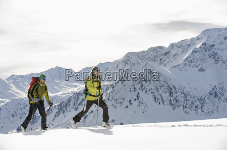 austria man and woman skiing on