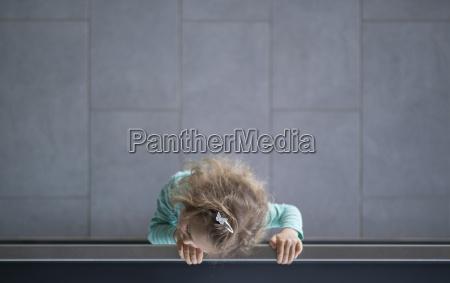 little girl looking over railing view