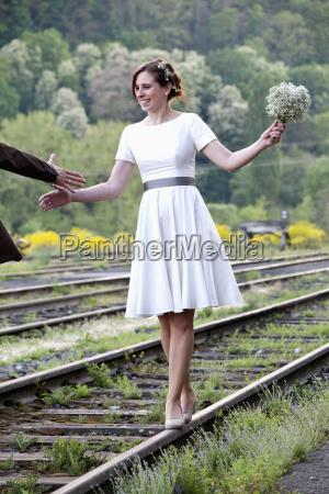 bride balancing on rail