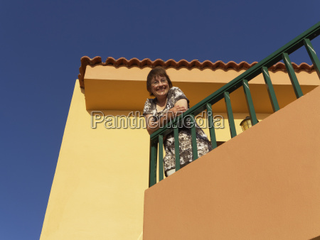 spain woman leaning on balcony of