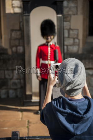 uk london boy photographing guard in