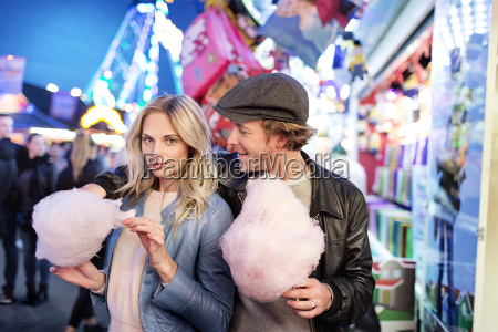 young couple at fun fair eating