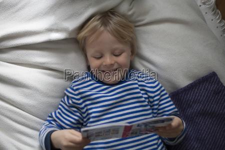 portrait of smiling little boy lying