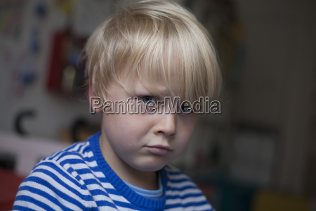 portrait of angry little boy
