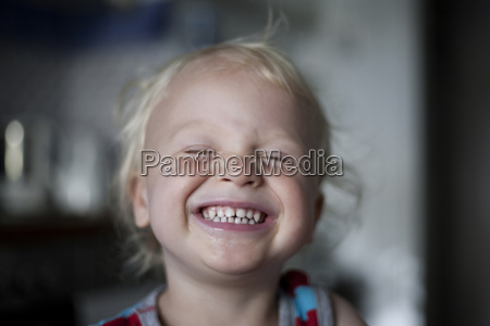 portrait of laughing little boy with