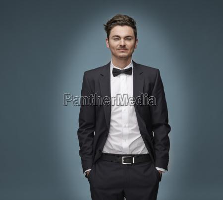 portrait of arrogant looking man wearing