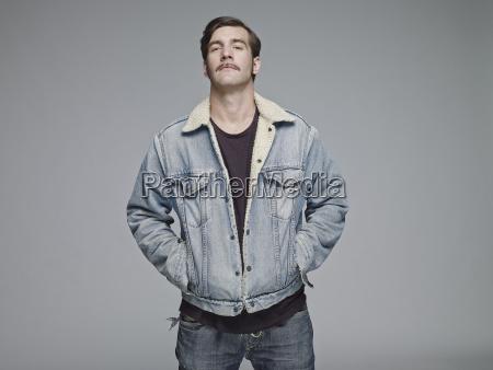 portrait of man wearing jeans jacket