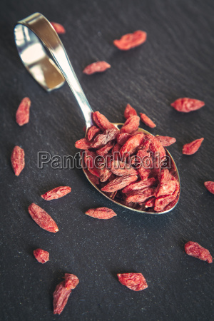 spoon of wolfberries on slate