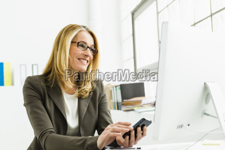 germany businesswoman using mobile phone and