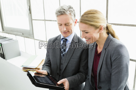 germany businesspeople working on digital tablet