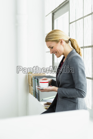 germany businesswoman with coffee cup smiling