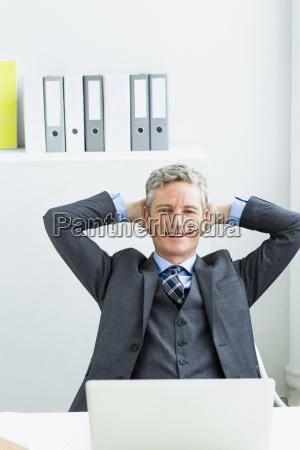 germany portrait of businessman sitting in