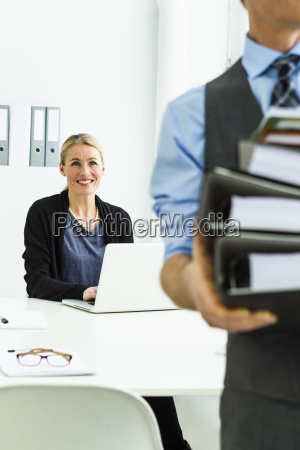 germany businessman holding stack of files